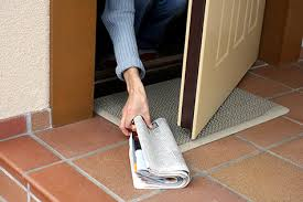 newspaper at door